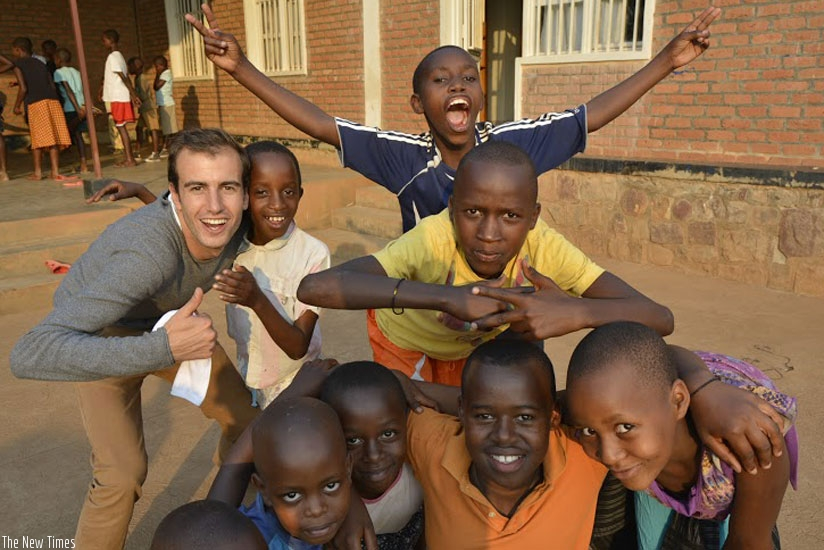 Olivier Demets (left) with some of the children at the Root Foundation. (Stephen Kalimba)