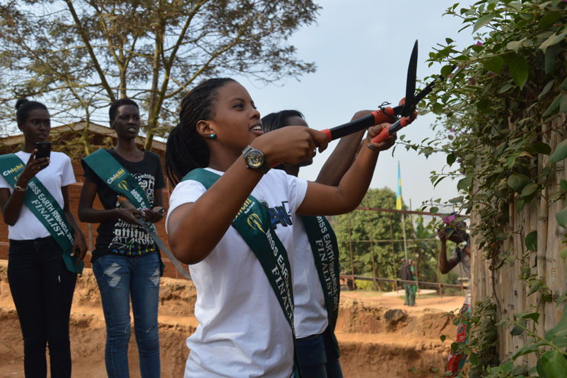 The Miss Earth contestants took part in the monthly community service Umuganda, in Gitega, Nyarugenge District on Saturday. (Stephen Kalimba)