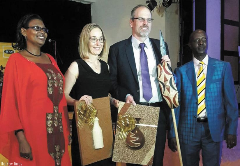 MTN new chief executive Engling (second right) and his wife Christine, were received with traditional gifts. Mary Asiimwe (left), MTN head of HR and Norman Munyampundu, the MTN Business chief, accompanied them. (Courtesy)