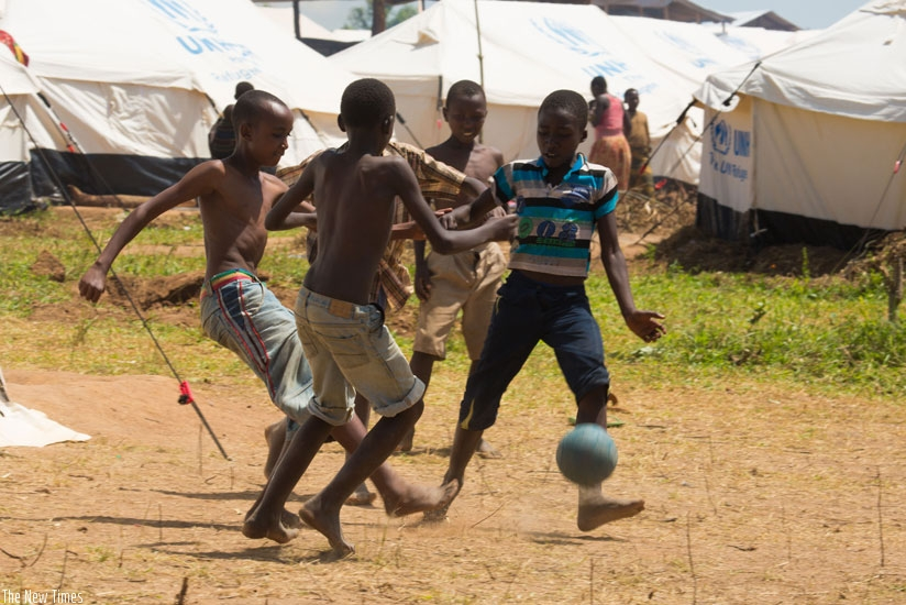 Refugee children play football at Mahama Refugee Camp. Sixty per cent of the Burundian refugees are children. (T.Kisambira)