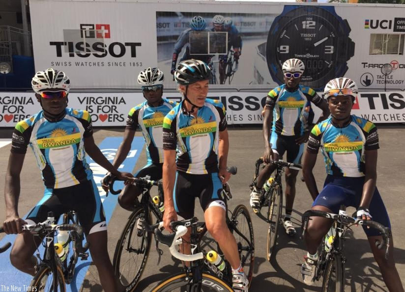 Team Rwanda cyclists pose for a photo with coach Jonathan 'Jock' Boyer (C) after training yesterday. (Courtesy)