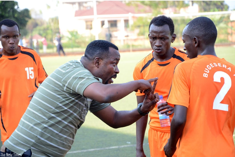 Bugesera coach Ali Bizimungu gives tactical instructions to his players during a league tie. Bizimungu wants FERWAFA to review the fixture schedule to allow players enough time to rest. (Sam Ngendahimana)