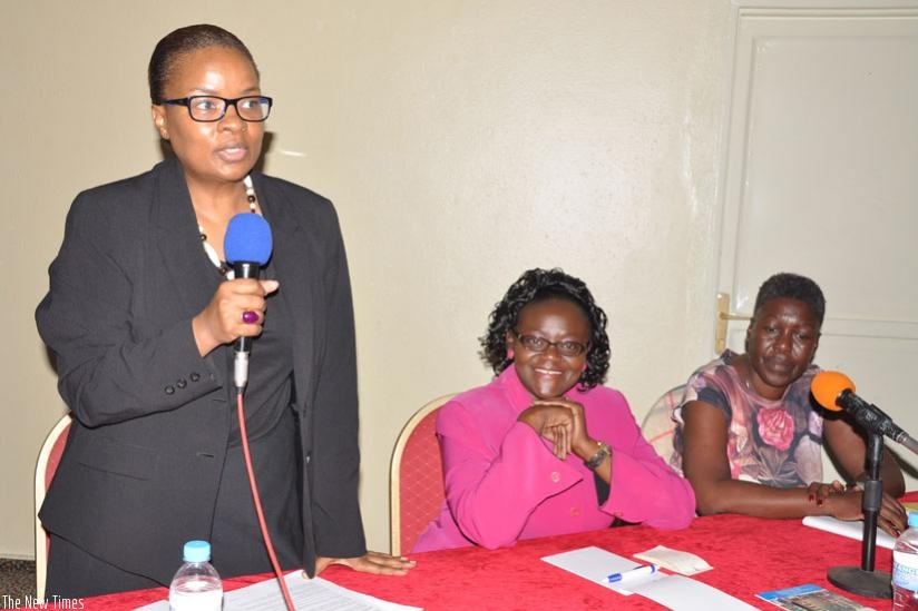 Dr Dludlu addresses participants at the sympossium for women living with HIV in Kigali on Wednesday as Anyangwe (C) and Onyango look on. (Sharon Kantengwa)