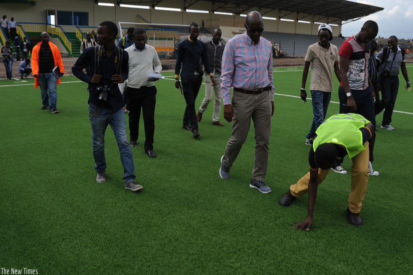 FERWAFA president Vincent Degaule Nzamwita takes journalists on a guided tour of the Stadium in Rubavu yesterday.  (Courtesy)