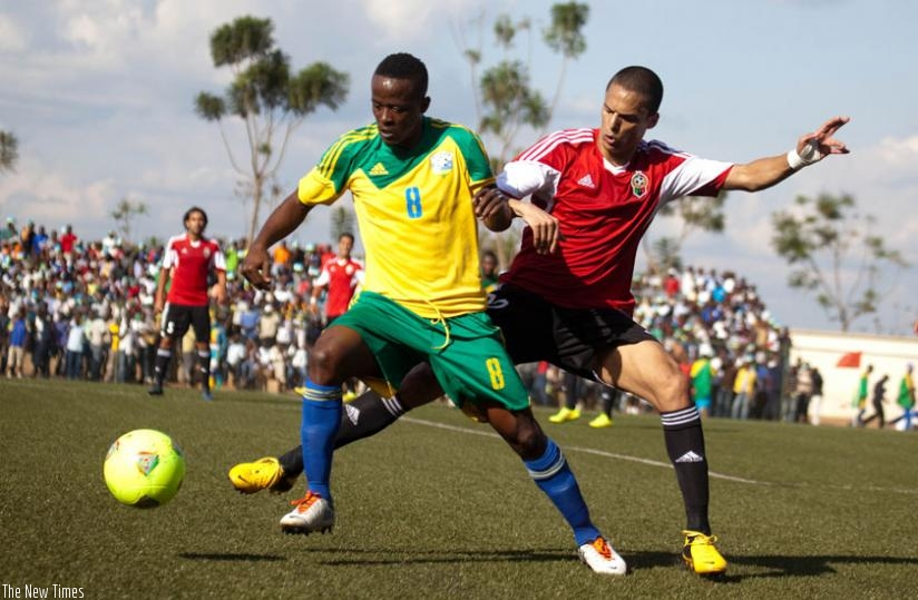 Amavubi captain Haruna Niyonzima shields the ball against a Libyan player during the last meeting between the two teams in Kigali. (File)