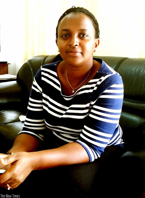 University of Rwanda's College of Medicine and Health Sciences new Principal, Jeanine Condo, at her office during the interview. (S. Kantengwa)