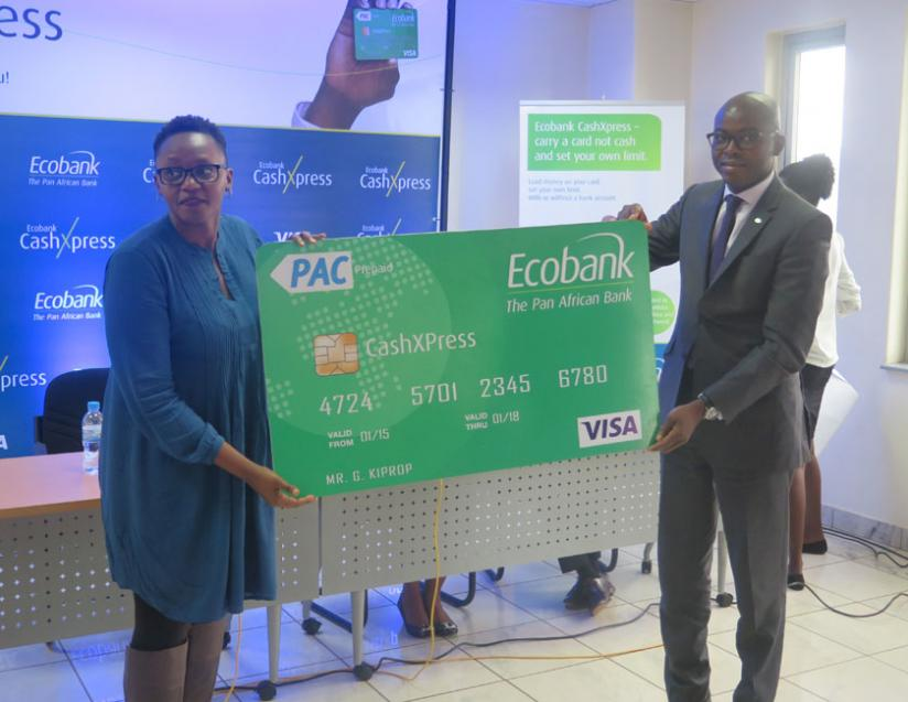 Lucy Mbabazi(L) VISA representative and Wilfrid Bocco, Head of domestic Banking at Ecobank display the prepaid cashXpress card.