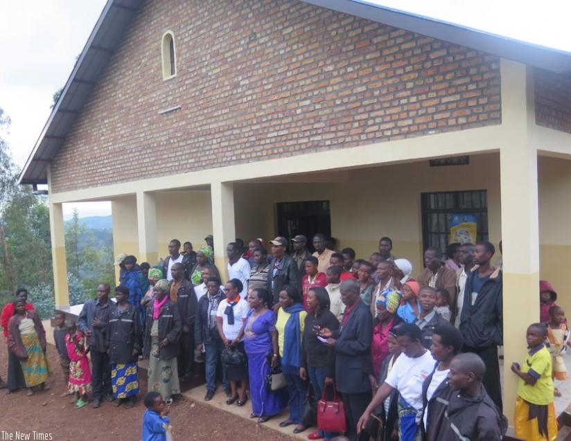 Nyankenke residents and sponsors pose for a group photo at the new health facility. (Frederioc Byumvuhore)