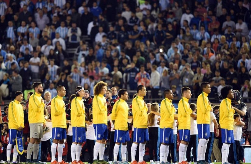 The Brazil team observe a minute's silence for the victims of the Paris attack ahead of their WCup qualifier with Argentina. (Net photo)