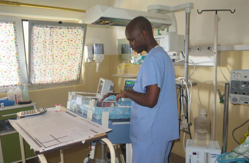 A nurse adjusts the position of a neonate in a hospital. The infants section is one of the high risk areas hence high standard safety precautions are needed there. (Solomon Asaba)