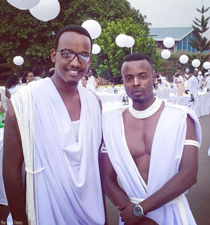 Moses Turahirwa (right) in Umwitero at Diner en Blanc with a friend. (Courtesy)