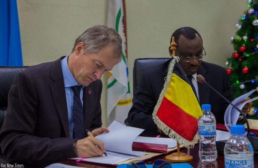 Amb. Pauwels  (L) and Minister Gatete signed  two bilateral development agreements in Kigali, yesterday. (Faustin Niyigena)