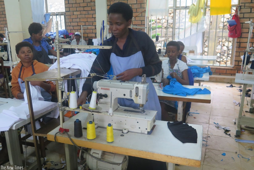 Girls learning tailoring. Short courses can be in any field such as tailoring which students can take on during the holiday. (Solomon Asaba)