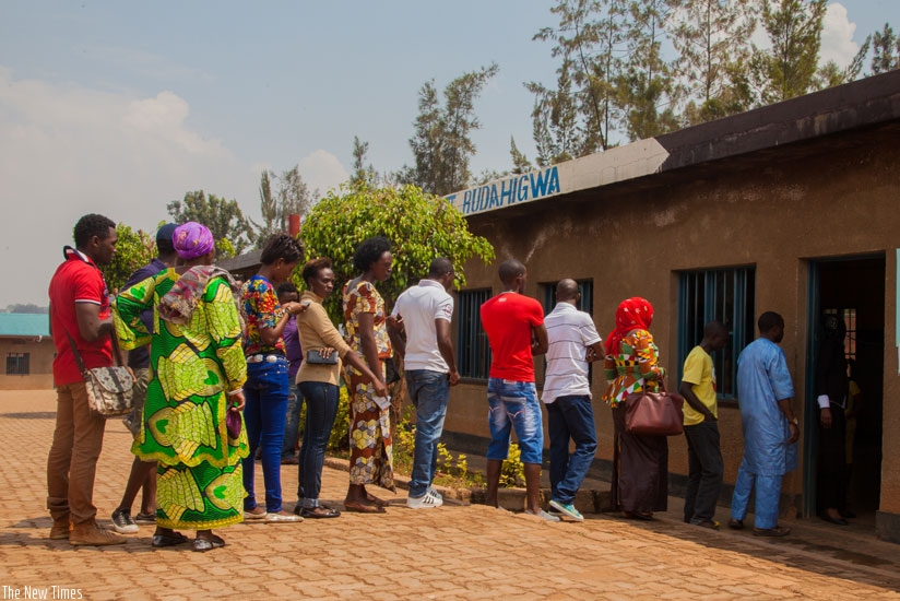 Voters line up at Ntwari polling station to vote in the recently concluded referendum. Elections dominated headlines in Rwanda and Tanzania last year and will dominate the region in 2016 with Uganda going to the polls in February and election fever gripping Kenya ahead of presidential elections next year. (Faustin Niyigena)