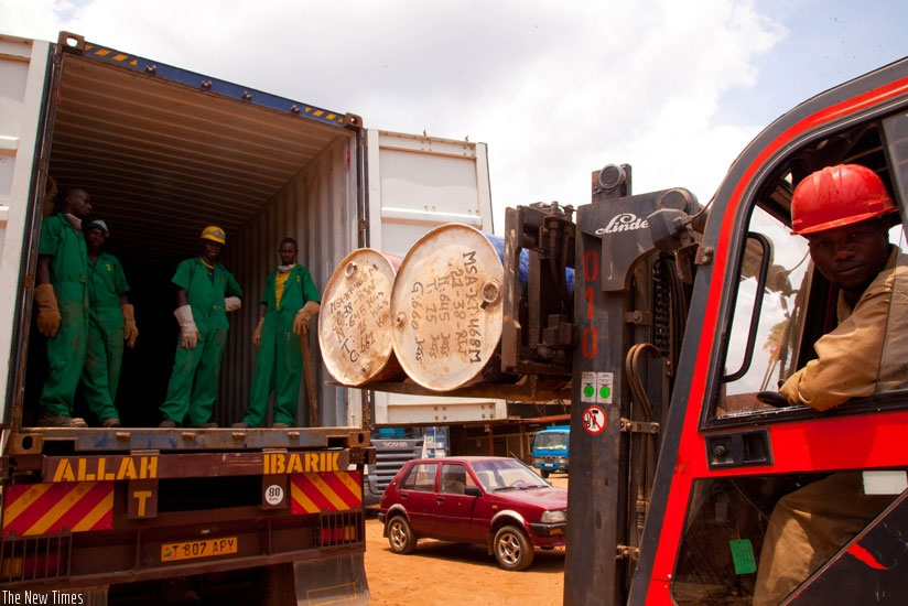 Workers at Mineral Supply Africa Company Ltd load containers of minerals on to trucks. The shipping firm has had to shift from Dar port over mysterious theft of coltan minerals destined for export. (File)