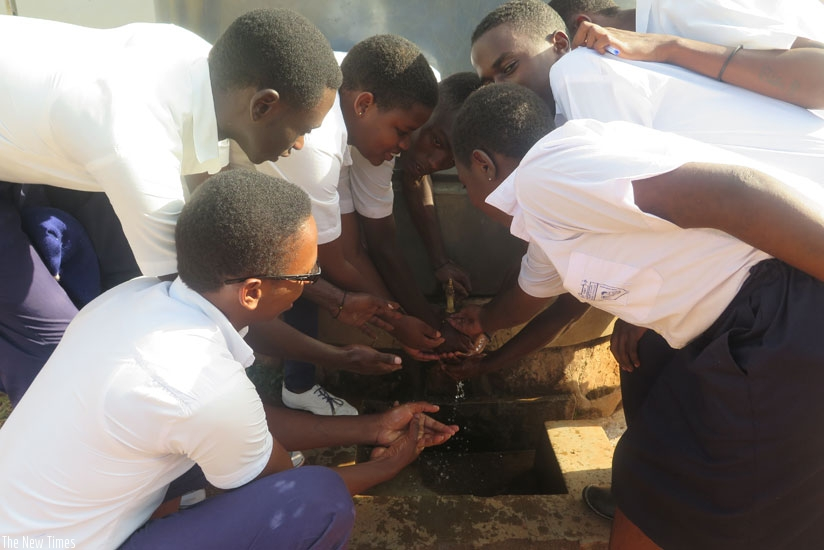 Students at GS Catholique de Butare wash their hands. Clean water is essential in maintaining the well-being of students and other people in a school setting. (Solomon Asaba)