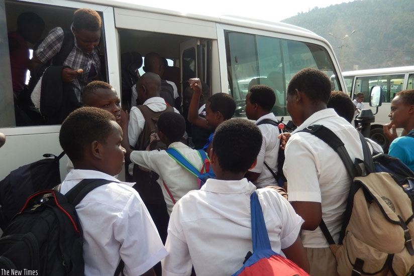 Students struggle to enter a bus after classes. With a sudden change of schools, such disruptions may be greater. (Solomon Asaba)