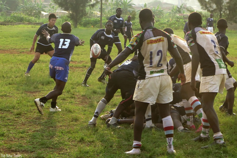Thousand Hills scrum-half Serge Shema (#13) tries to pass the ball in the league game against Kigali Sharks last season. (Stephen Kalimba)