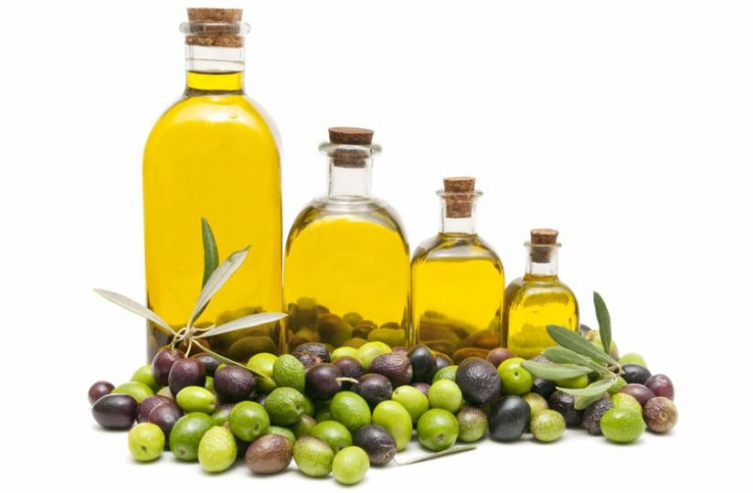 Bottle containing olive oil and olives where the oil is extracted from. (Net photo)