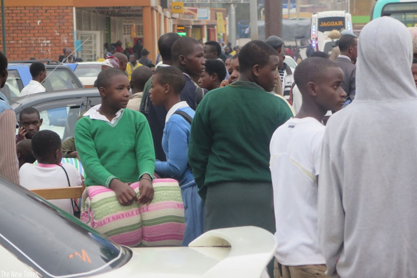 Students at Nyabugogo bus terminal waiting for a bus. It is advisable that students depart for school early to be able to reach in good time. (Solomon Asaba)