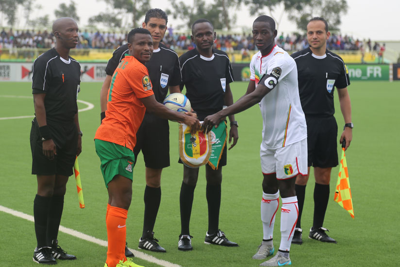 Zambia captain, Christopher Katongo (2nd left) and Mali captain Karim Dante (2nd right) exchange pennants before kick off earlier today (Peter Kamasa)