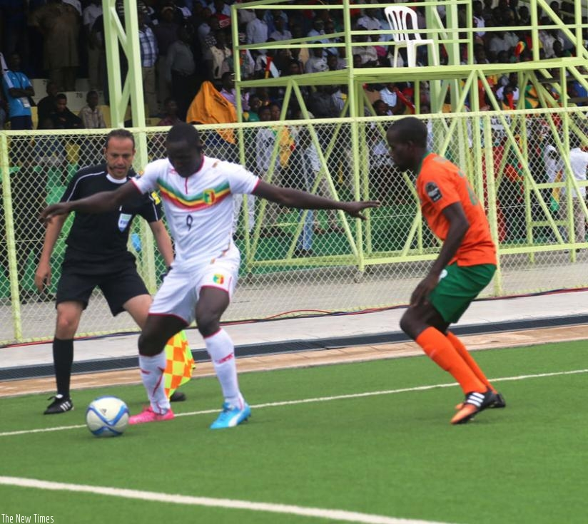 Striker Hamidou Sinayoko of Mali shields the ball from a Zambian defender during their final Group D match. Both teams advanced to the last eight. (P. Kamasa)