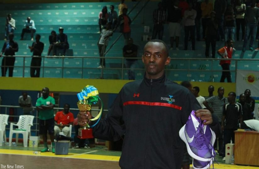 Patriots' and former Espoir playmaker Arstide Mugabe shows off his MVP awards after his side Patriots beat Espoir in the final on Monday. (Elise Mpirwa)