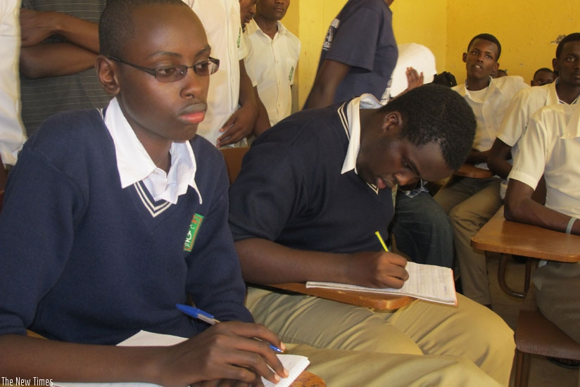 Students attend a lesson. Timely payment of school fees improves concentration during class work. (Solomon Asaba)
