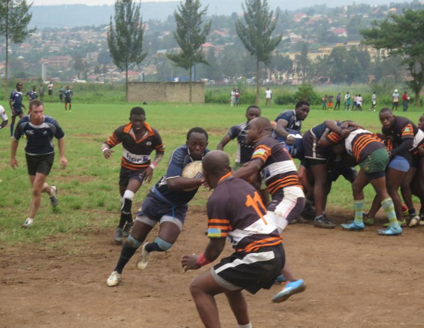 Thousand Hills' Fidel Castro Mugabo looks for a gap in Remera's defence line on Saturday at Utexrwa. (S. Kalimba)