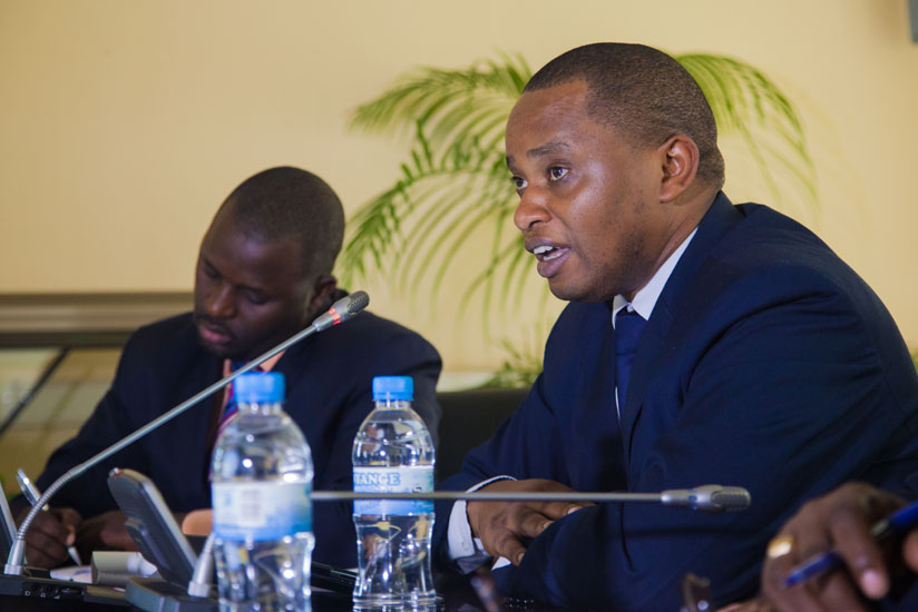 State Minister for primary and secondary education Olivier Rwamukwaya (R) speaks to the press as REB chairperson Janvier Gasana takes notes. (Faustin Niyigena)