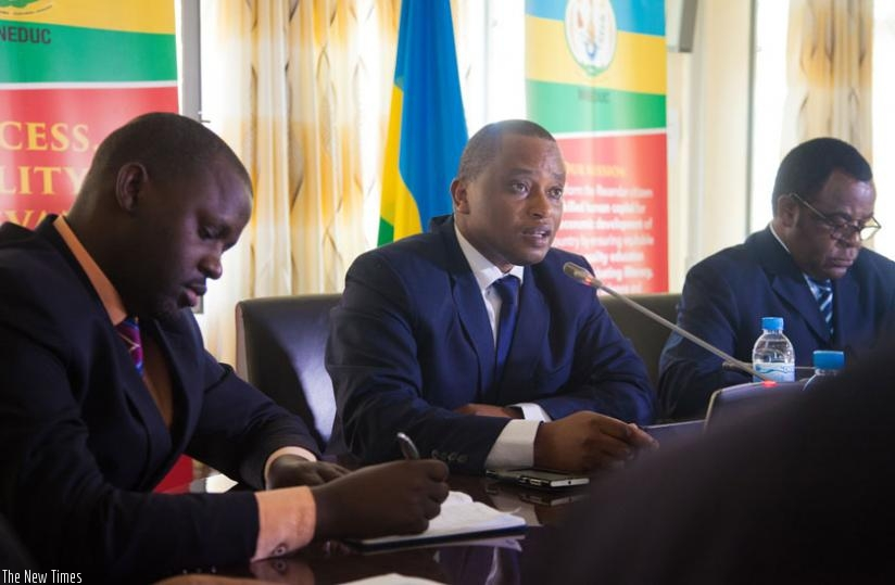 Minister Rwamukwaya (C) speaks after releasing the results yesterday as Rwanda Education Board director-general Janvier Gasana (L) and George Njoroge, the principle of University of Rwanda's College of Education take notes. (Faustin Niyigena)