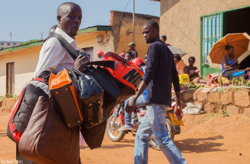 A hawker sells second hand bags on the streets of Kimisagara.  (Faustin Niyigena)