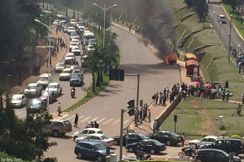 A Mercedes Benz caught fire at Gishushu No one was hurt. (Photos by Peterson Tumwebaze and Faustin Niyigena)