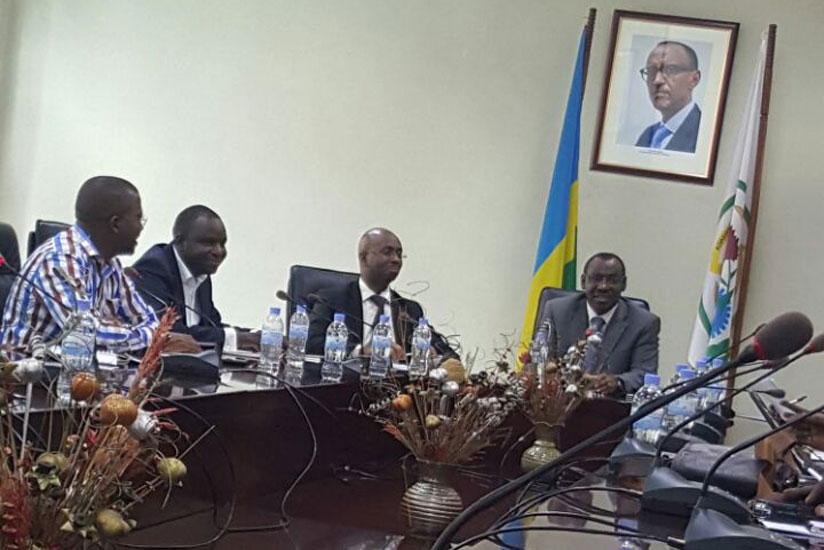The head of the National Institute of Statistics of Rwanda, Yusuf Murangwa, (2nd R) flanked by Finance minister , Claver Gatete (R) (Photo by Bryan Kimenyi)