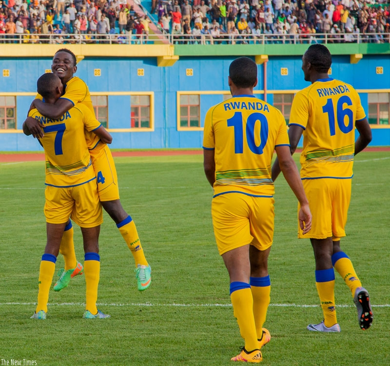 Jean Baptiste Mugiraneza (No. 7) celebrates his late goal with Muhadjiri Hakizimana, to complete Rwanda's 5-0 rout of Mauritius at Amahoro National Stadium in Kigali yesterday. (Faustin Niyigena)