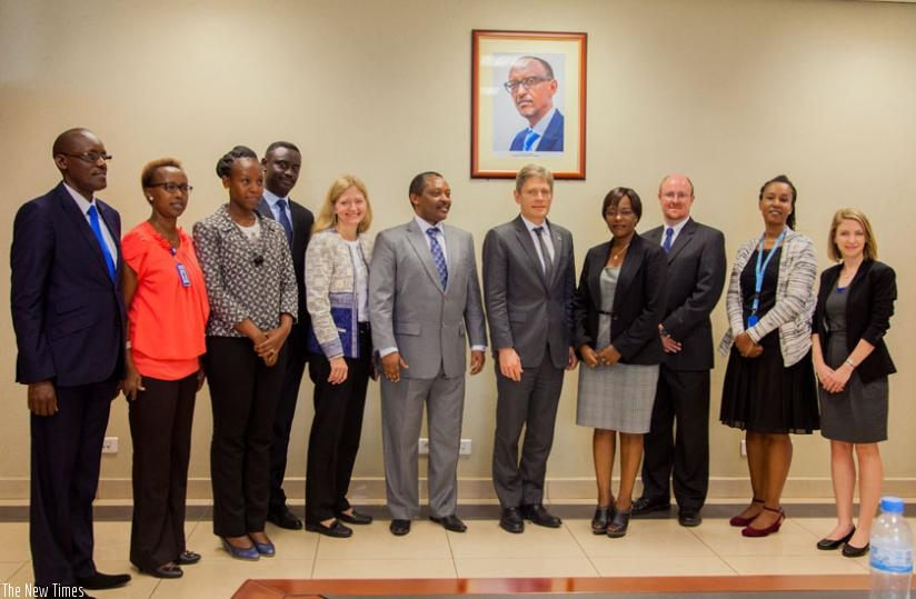Officials pose for a group photo after the meeting at RGB offices in Kigali, yesterday. (Faustin Niyigena)