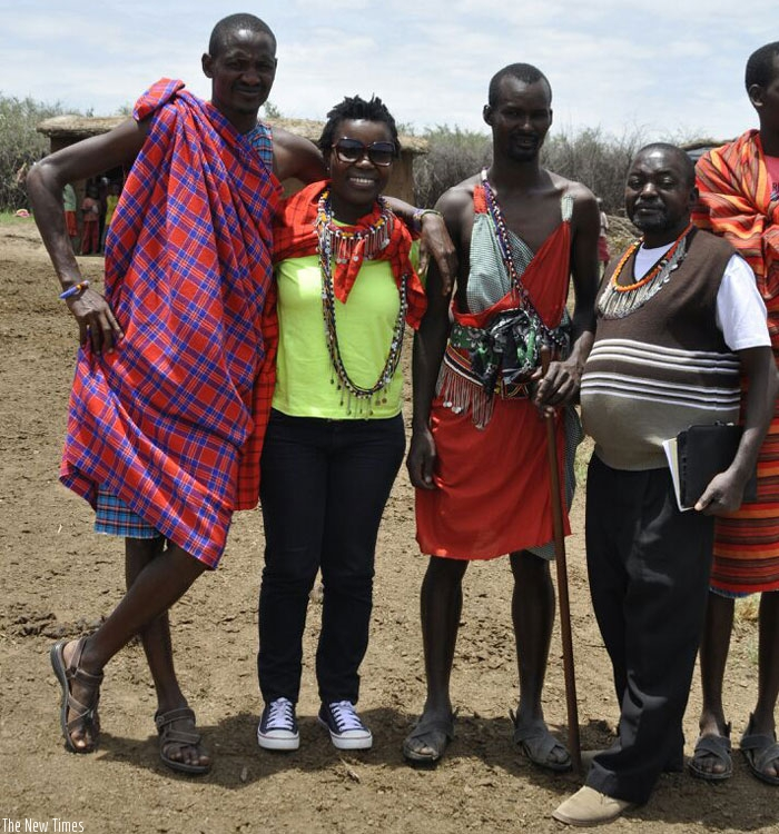 The writer (second left) with Masai herdsmen and a KTB official during the trip. (Courtesy)