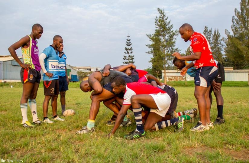 Jean Baptiste Itanzi (standing right) conducts a scrum session at Utexrwa during a past training session. (S. Kalimba)