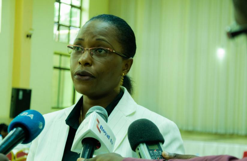 1461877636The-Permanent-Secretary-in-MINIJUST-Isabelle-Kalihangabo-speaks-to-the-media-at-the-workshop-yesterday