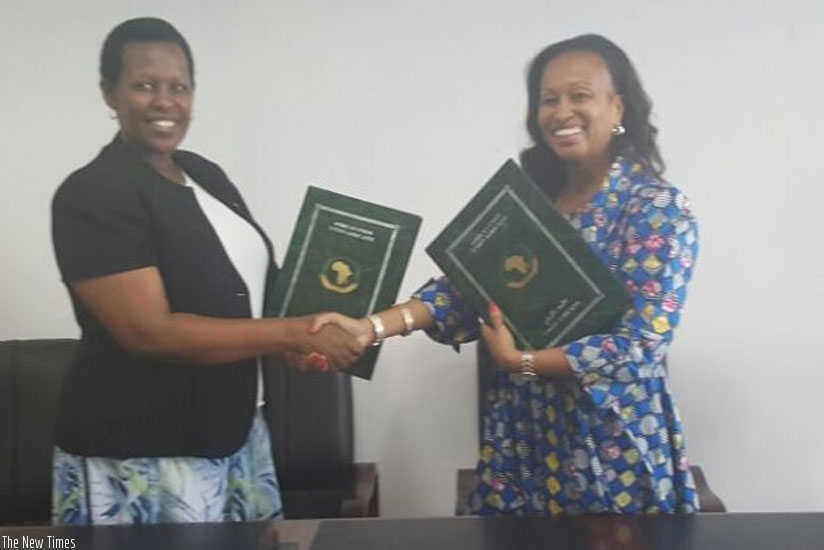 Ambassador Tumukunde (L)and Ms Diarra after signing the AU Summit host agreement (Courtesy)