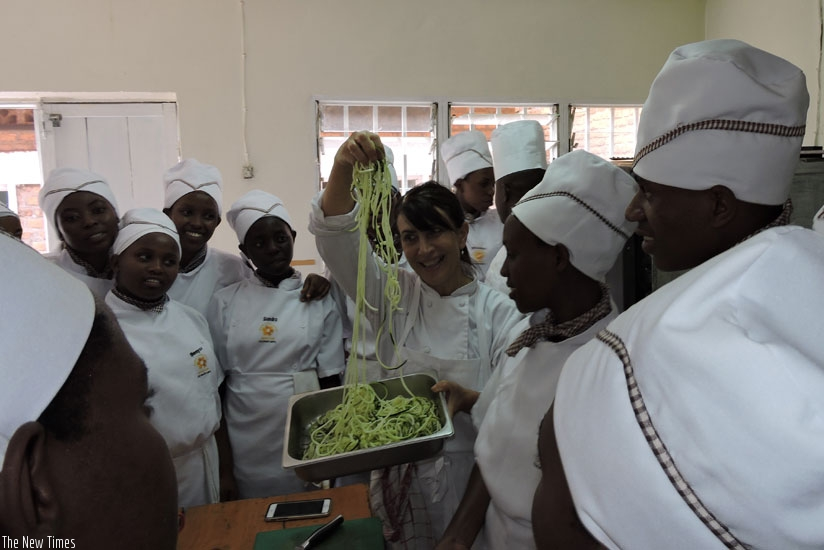 Bianco (C) shows students at Esthers Aid Culinary School how to prepare salads. (Solomon Asaba)