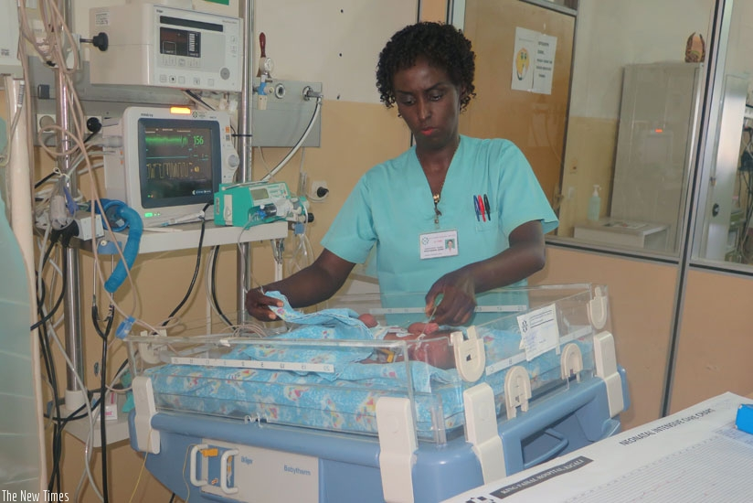 A nurse attends to a premature. Nurses need good remuneration to do their work well. (Solomon Asaba)