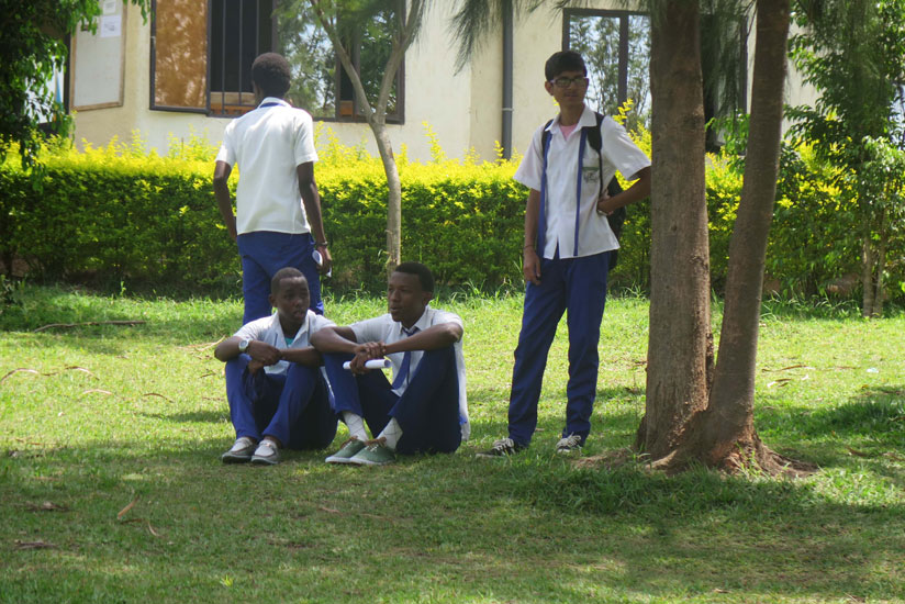 Students relax in a school compound. Peer pressure could drive students into drug abuse. (Solomon Asaba)