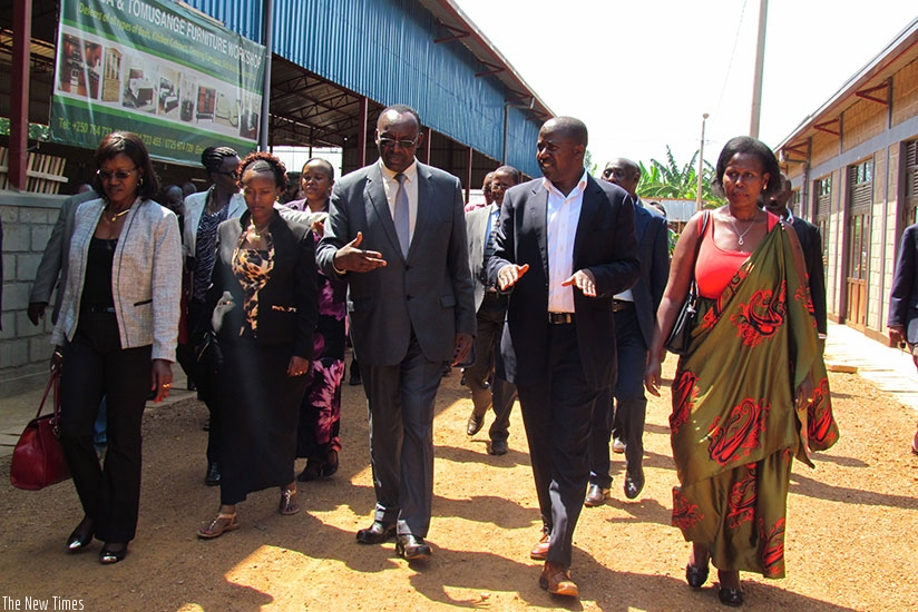 Kanimba (C) with other officials tour the new business centre in Kicukiro District after its inauguration. (Frederic Byumvuhore)