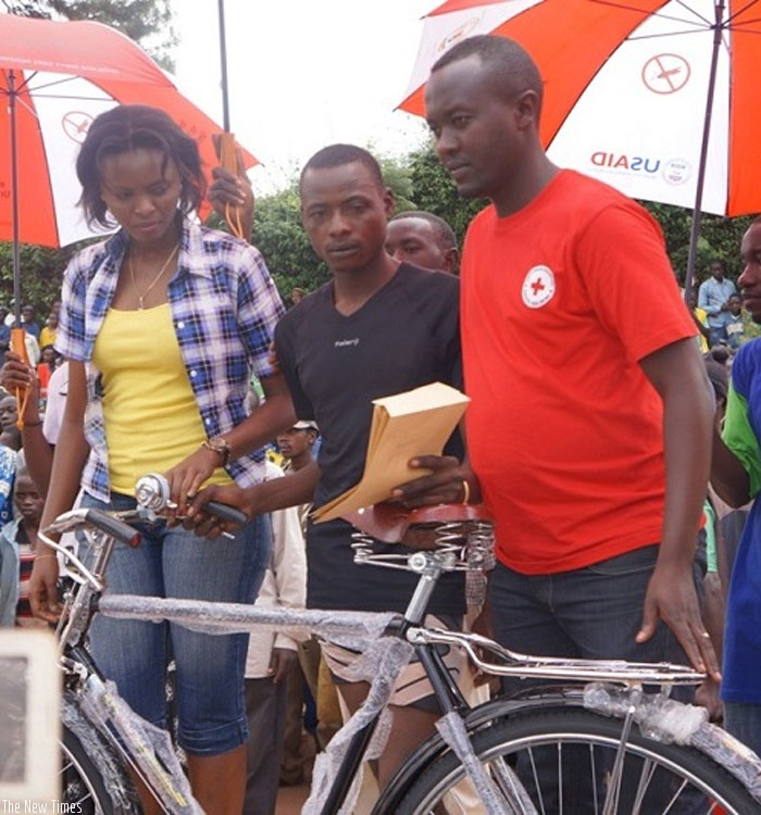 Jean Pierre Ahorukomeye (C) was awarded a new bicycle  after winning  the Gisagara race. (Courtesy)