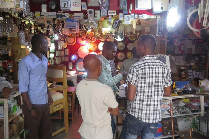 People buy items from an electronics shop. Young businesses need more creativity to thrive. (Solomon Asaba)