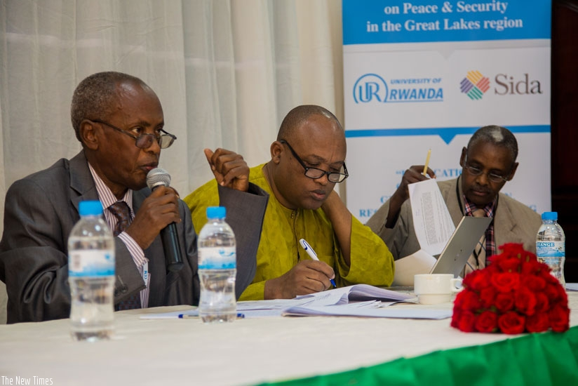 Prof. Nkusi (L) addresses participants as Ndahiro (C) and University of Rwanda don Dr Charles Gasarasi take notes at the conference in Kigali, yesterday. (Faustin Niyigena)