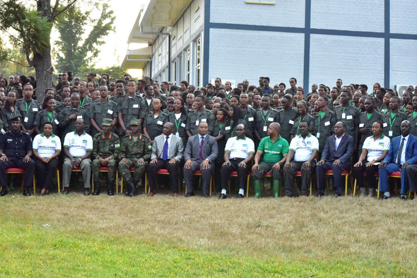 Rwamukwaya (C) in a group photo with other government officials and students after the launch of the civic education at Gabiro Combat Training School. (Nadege Imbabazi)