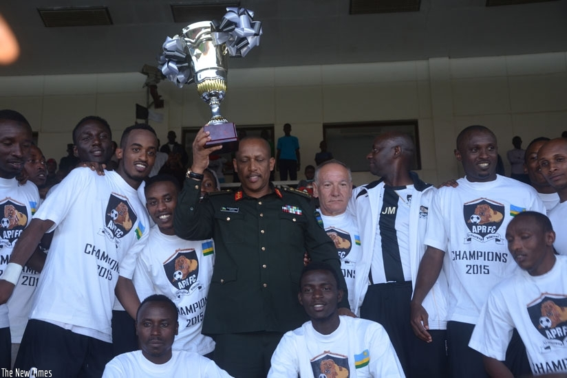 Gen, Patrick Nyamvumba, Chief of Defence Staff of the Rwandan Defence Forces (C) holds the trophy after APR were crowned league champions in 2015. (File)