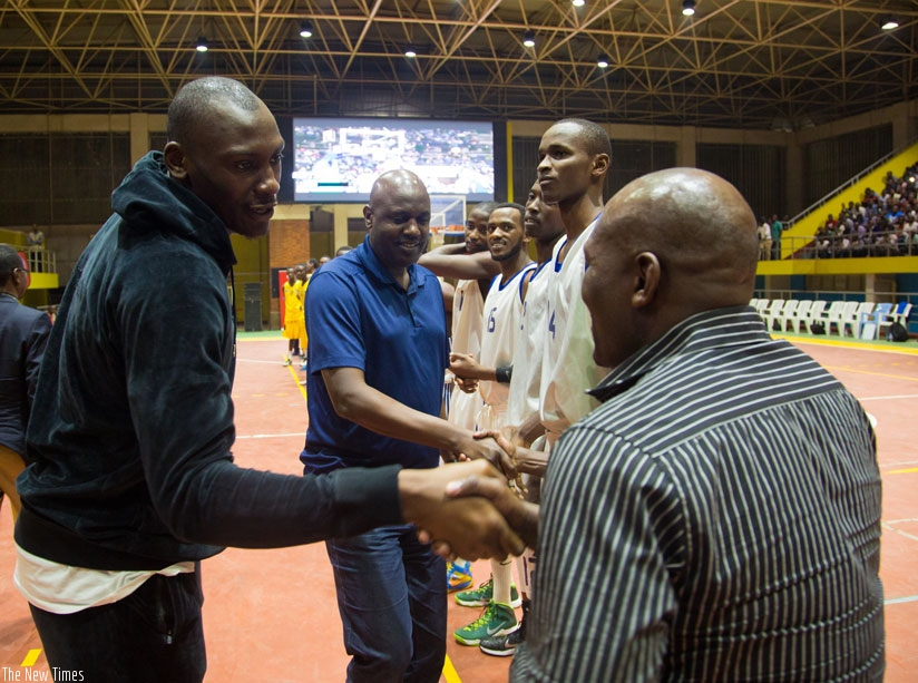 Orlando Magic centre Bismack Biyombo Sumba (L) greets Patriots All-Star players and officials before their game against the U-18 team on Wednesday at Amahoro indoor stadium. Centre in a blue T-shirt is FERWABA president Desire Mugwiza.( F. Niyigena)